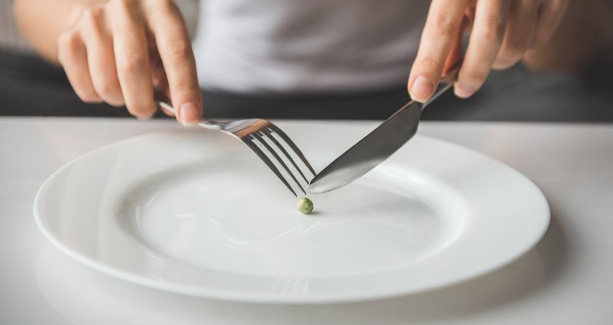 Someone chasing a pea around a plate