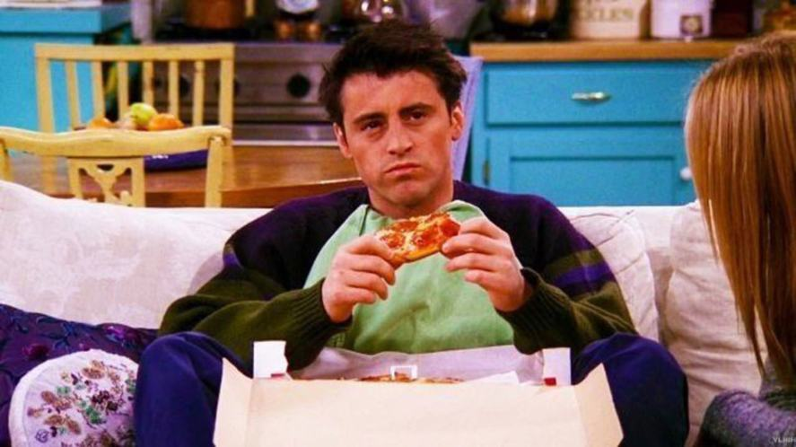 Joey eating pizza