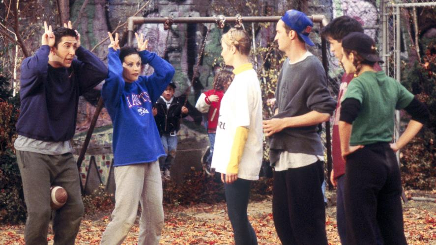 The cast play a game in the park