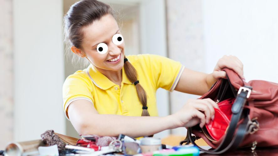 A lady rummaging through a messy bag