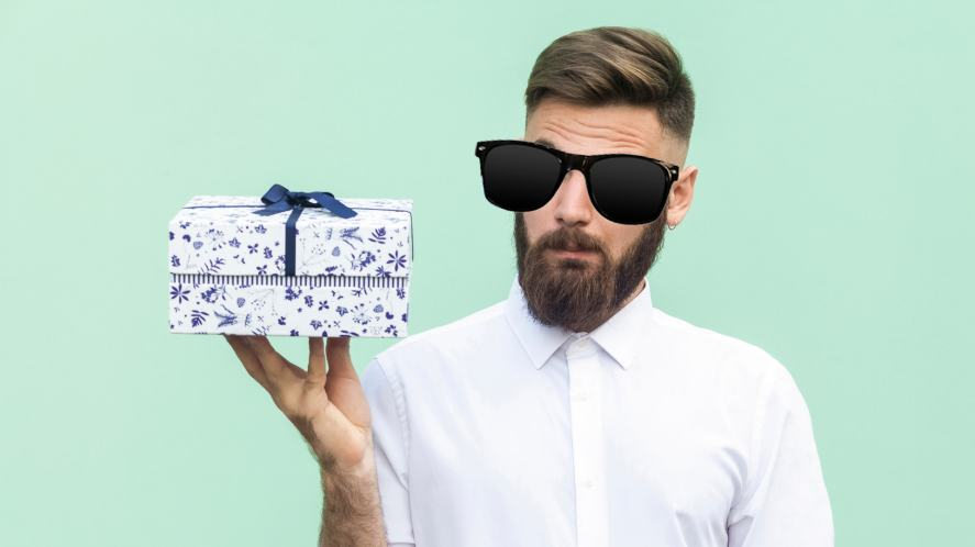 A man in sunglasses looking at a box