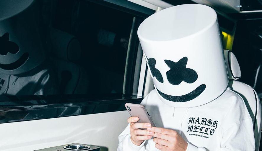 DJ Marshmello checks his mobile phone