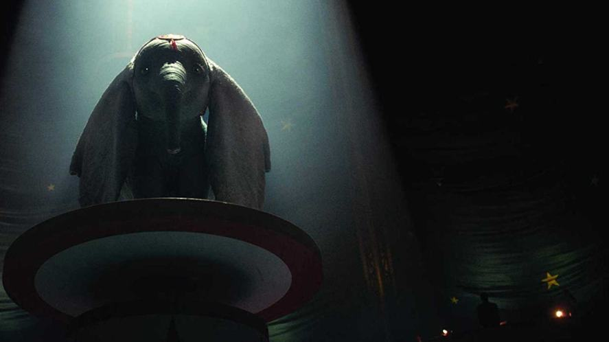 Dumbo standing on a podium in the new version of the film