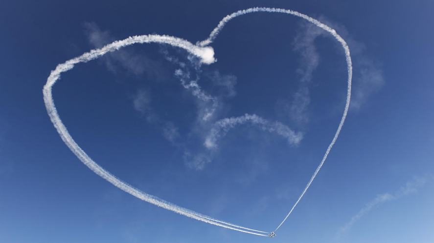 Stunt planes drawing a heart in the sky