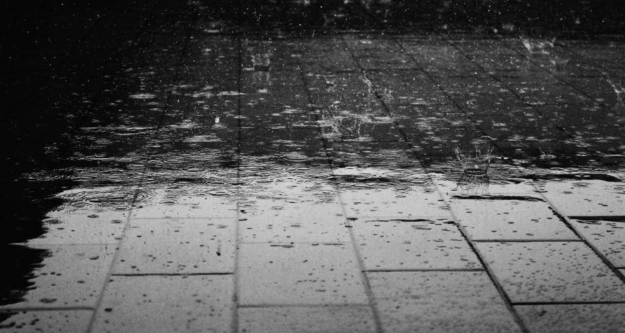 Rain bounces of a wet pavement