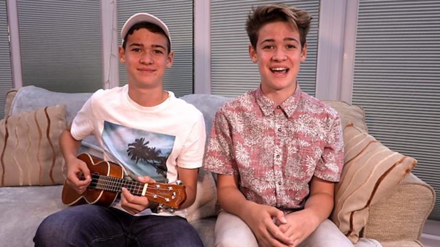 Max and Harvey perform music on their BBC show