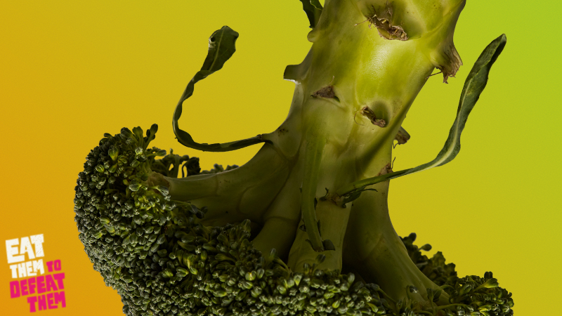 An upside down broccoli on a green background