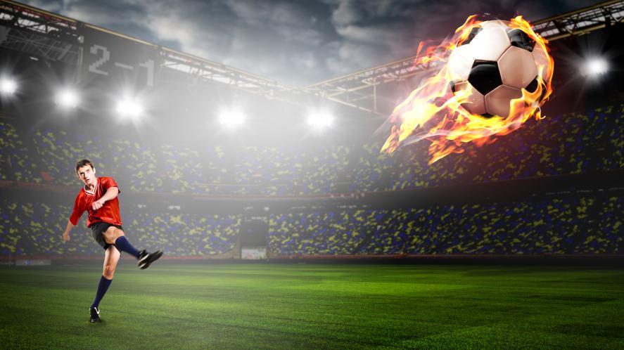A footballer kicks the ball so hard it bursts into flames