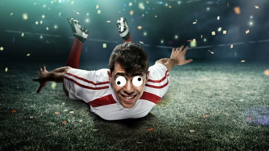 A footballer celebrates a win