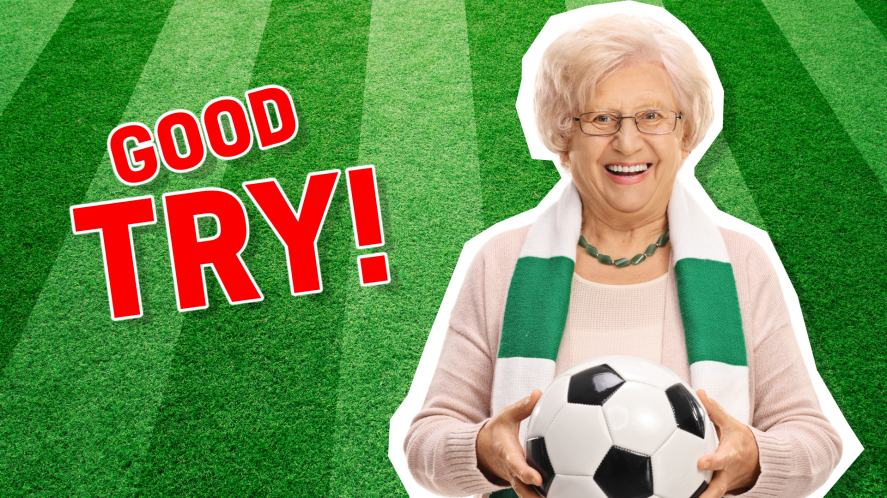 An elderly lady holding a football and smiling