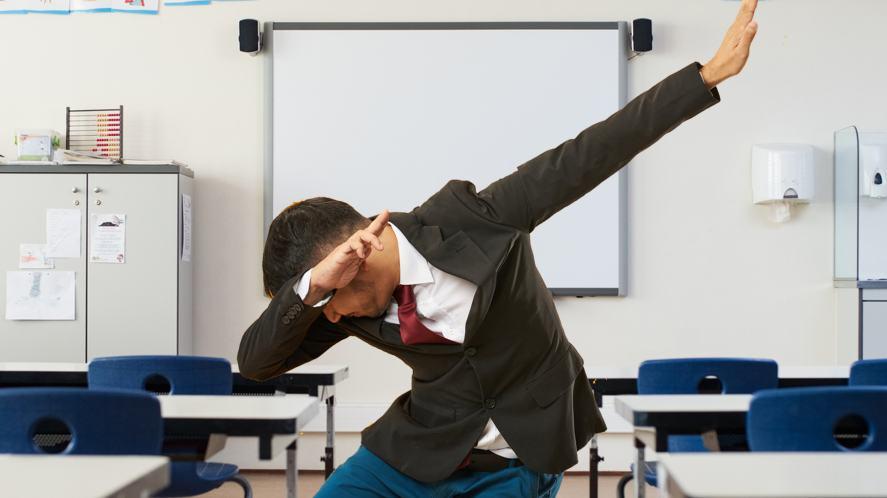 A teacher dabbing in the classroom
