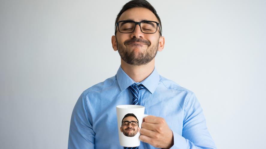 A teacher holding a mug