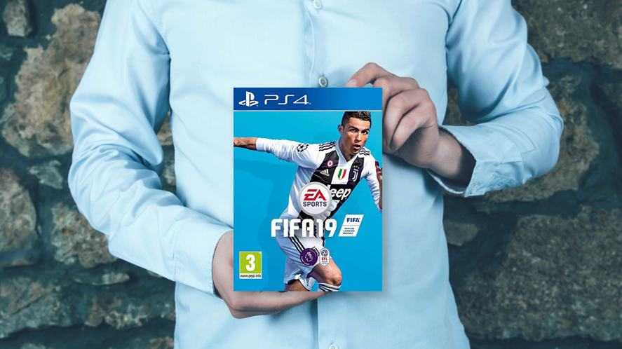 A person holding FIFA 19