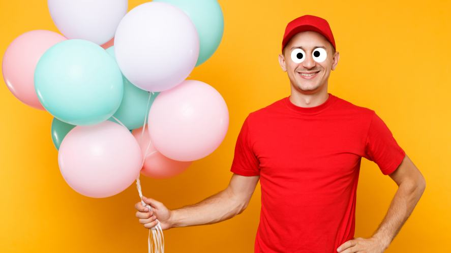 A man holding a bunch of balloons