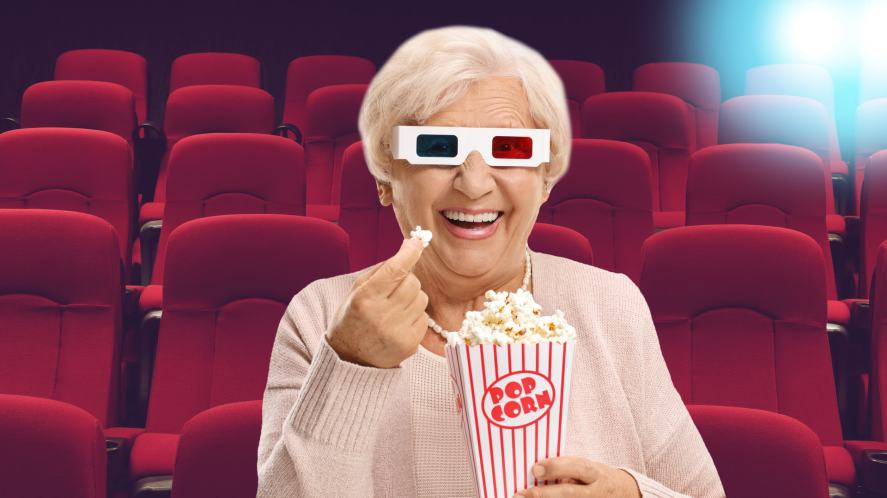 Someone enjoying some popcorn at a quiet cinema