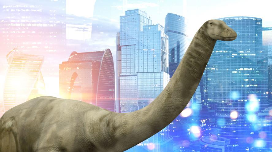 A brontosaurus wandering around a city