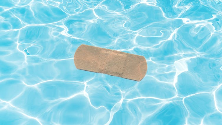 A used sticking plaster in a swimming pool