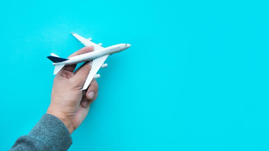 A hand holding a model aeroplane