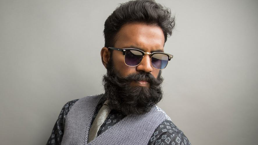 A man with sunglasses and a thick beard