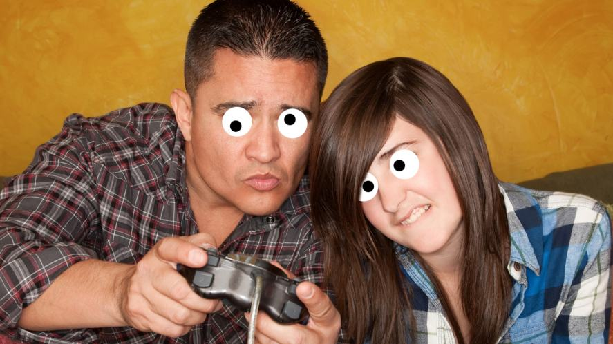 A father and daughter playing video games