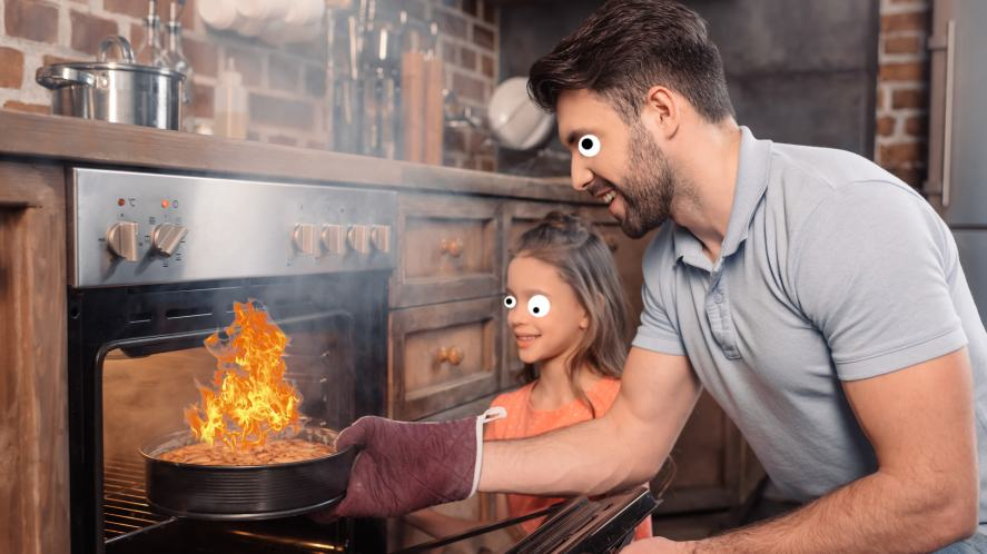A dad pulls a burnt cake out of the oven
