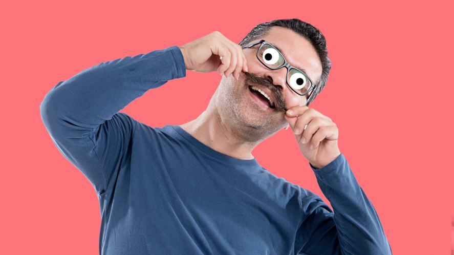A man twirling his moustache