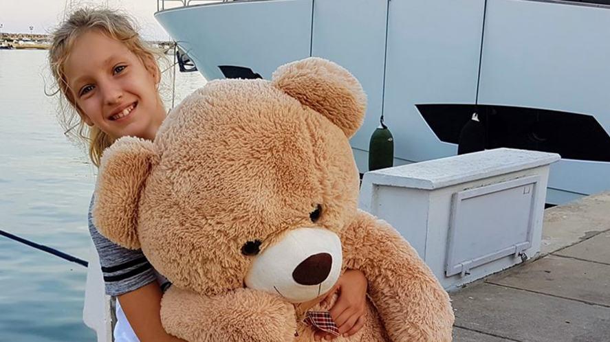 Sis holding a massive bear