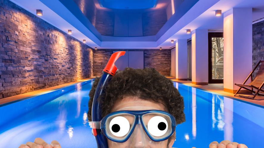 A man in a snorkel at a fancy swimming pool