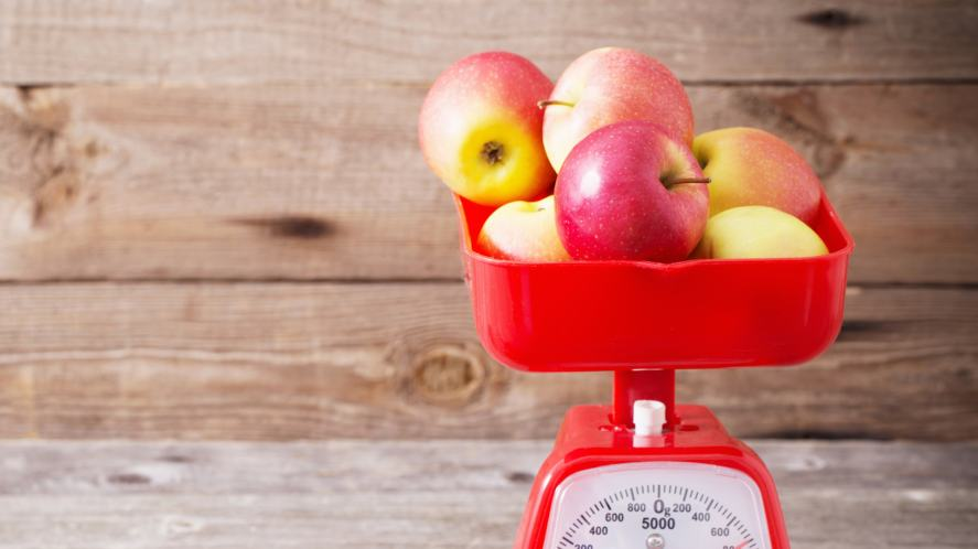 Kitchen scales weighing some apples