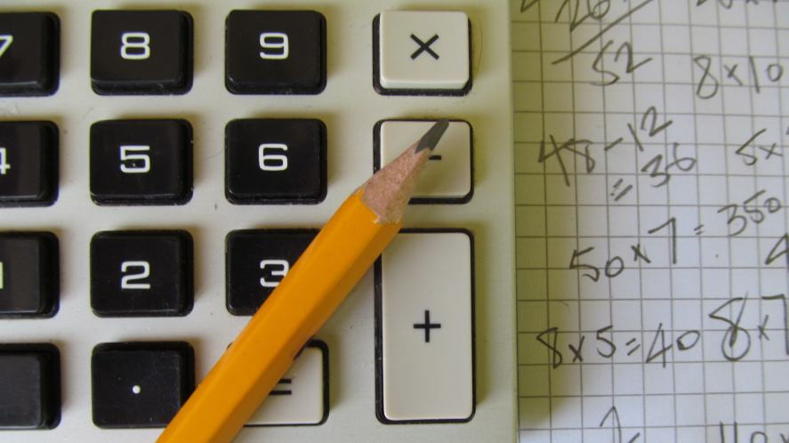 A calculator and pencil