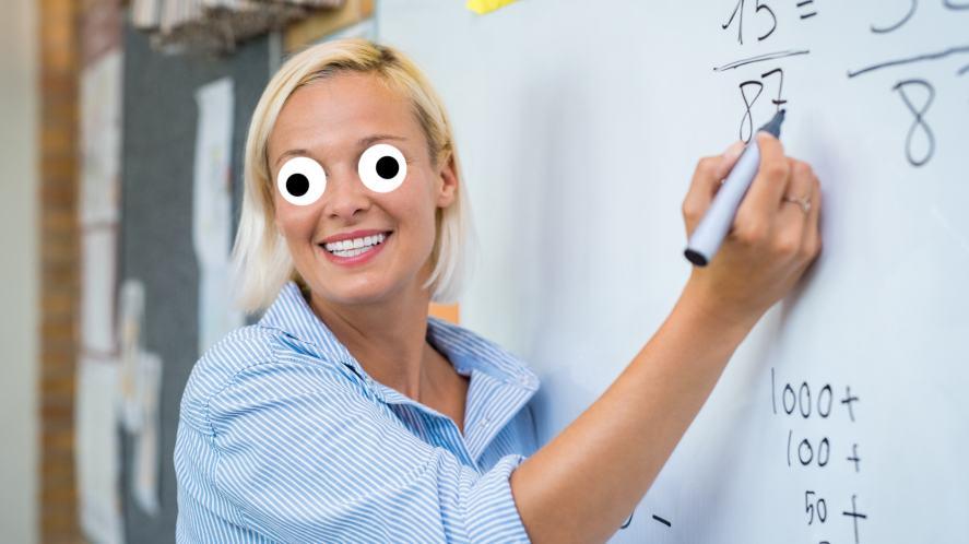 A teacher leading a maths lesson