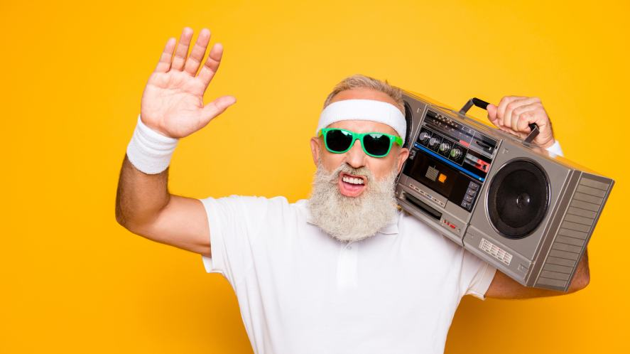 A grandad rocking out to music on his stereo