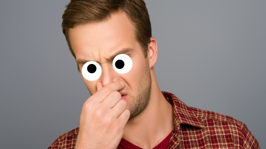 A man holding his nose