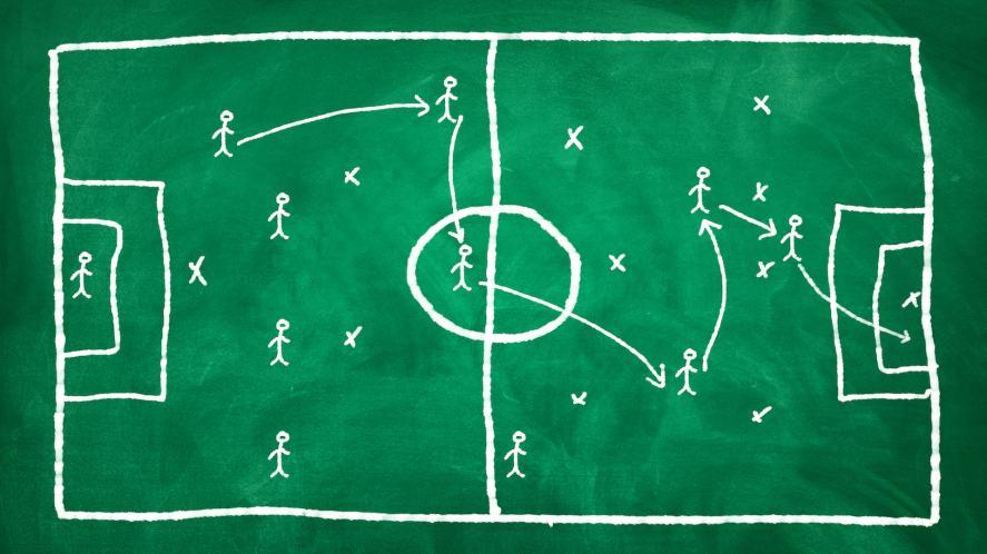 Football tactics on a green chalkboard