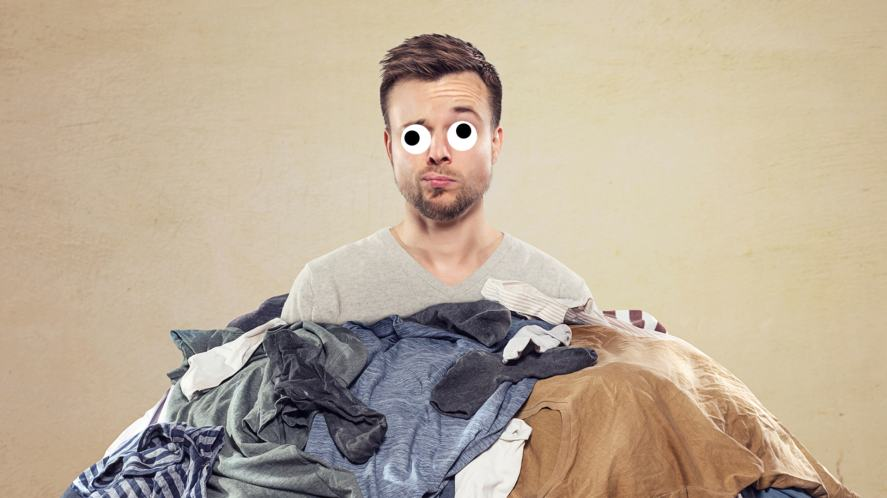 A man surrounded by laundry