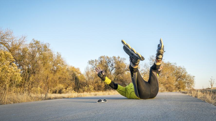 A person falling over during a rollerblading adventure