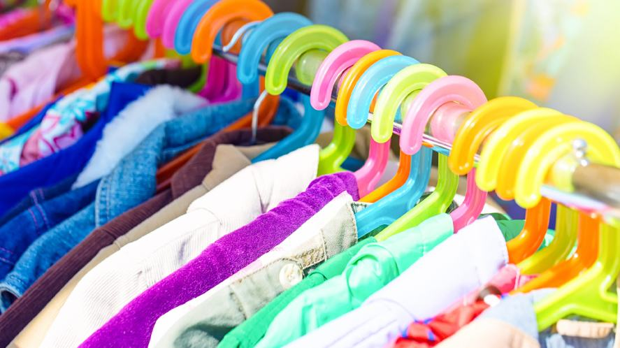 A clothes rack full of colourful stuff