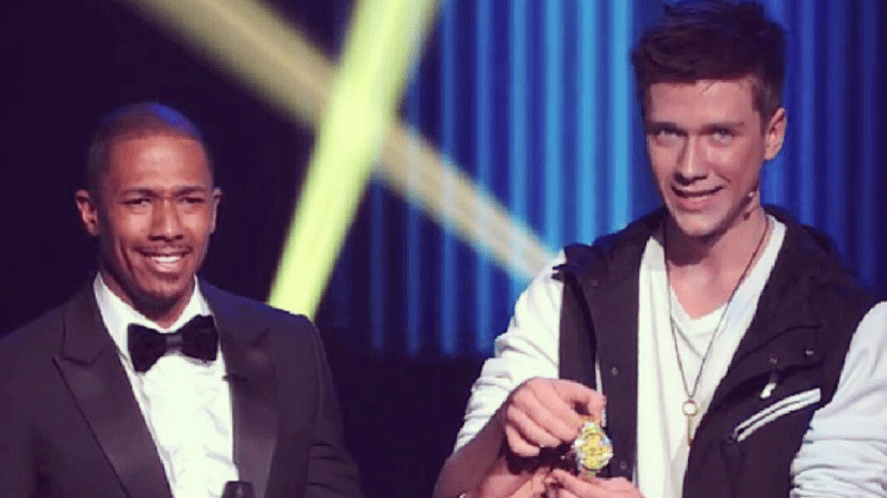 Collins Key and Nick Cannon on a TV show in 2013 | How Well Do You Know Collins Key?