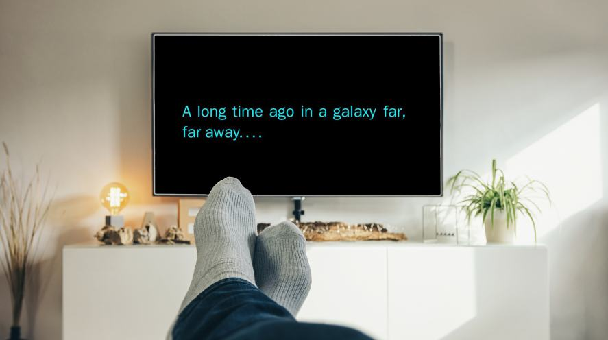 A person relaxing watching a Star Wars movie