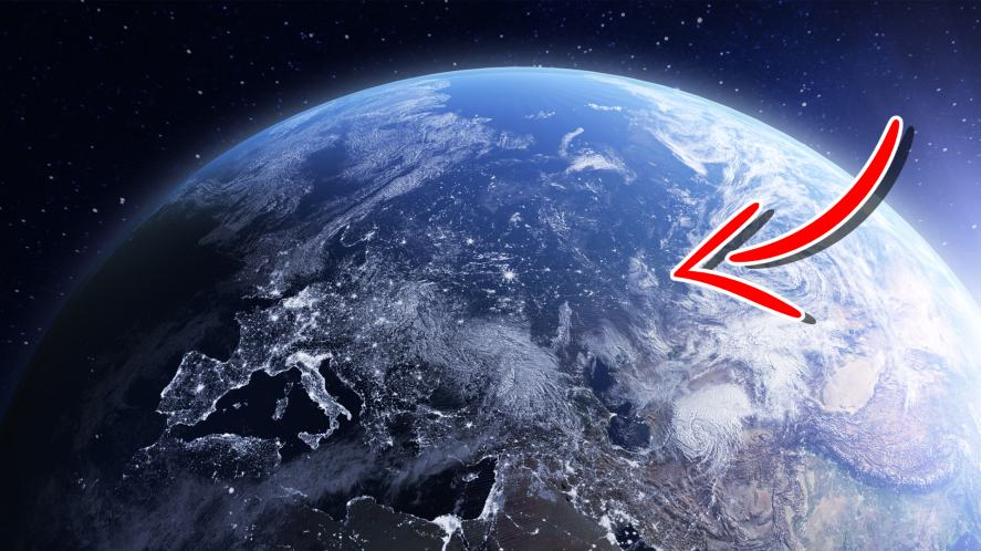 An arrow pointing to Earth