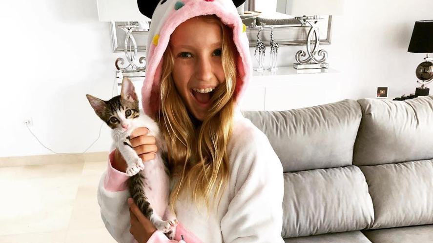 Karina and one of her family's pet cats