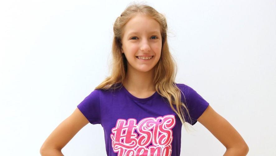 Karina in a purple t-shirt