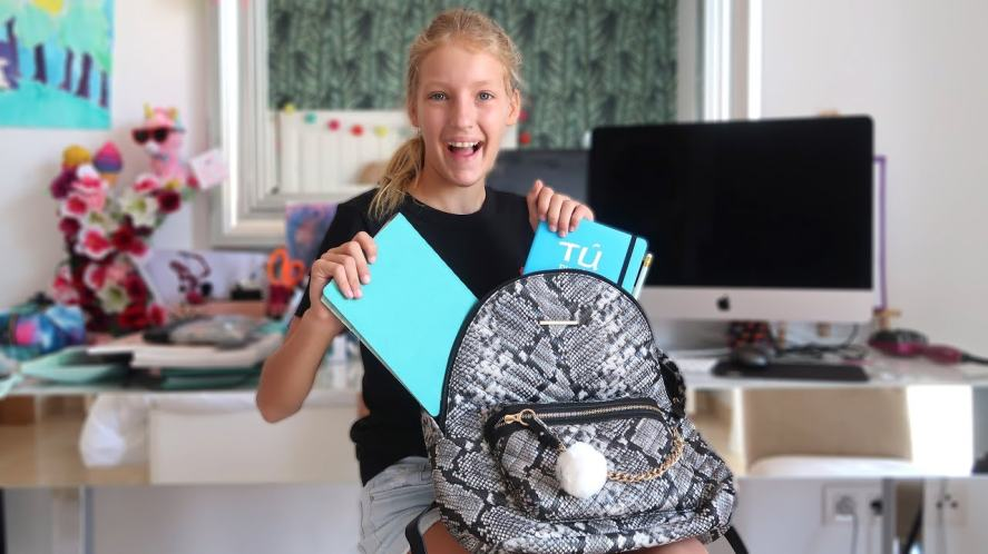 Karina packs her school bag