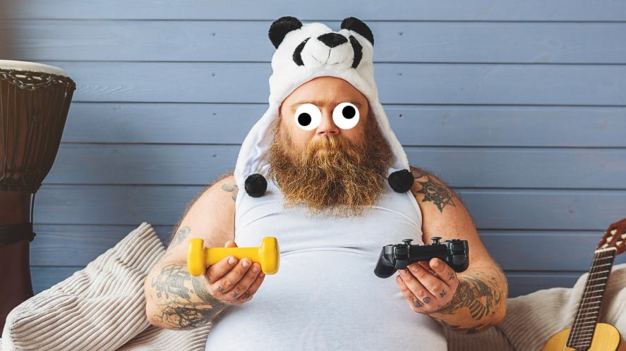 A man wearing a Panda hat holding two video game controllers