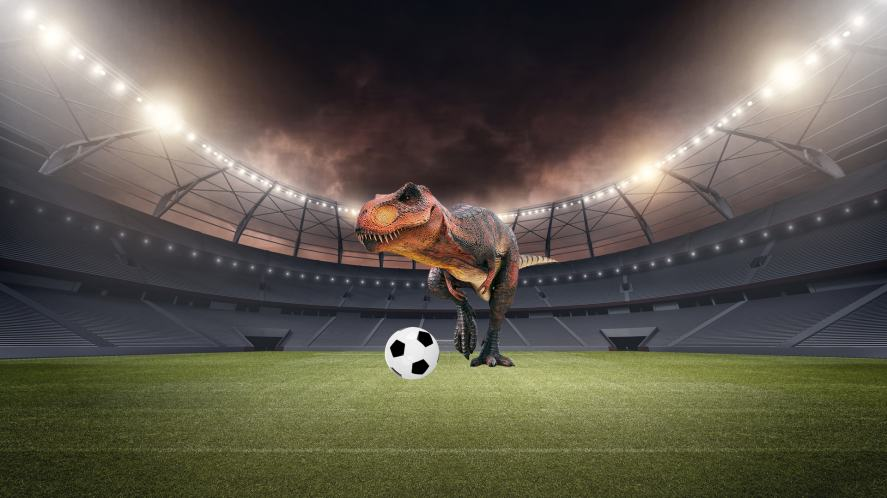 A dinosaur playing football