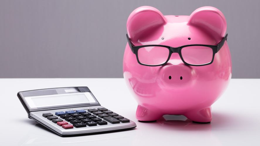 A piggy bank and calculator