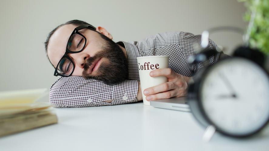 A man napping at his desk