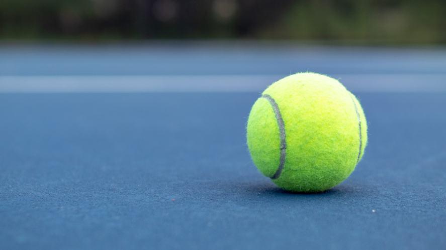 A tennis ball on the floor