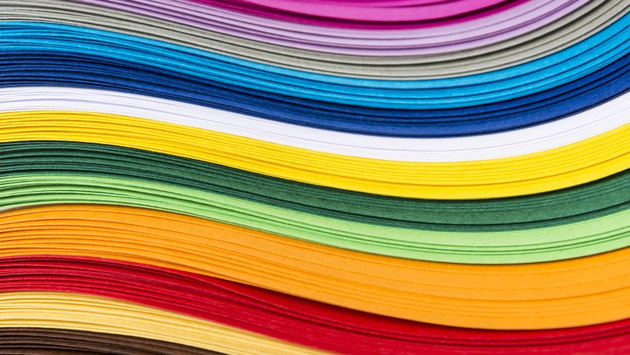 A pile of brightly coloured paper