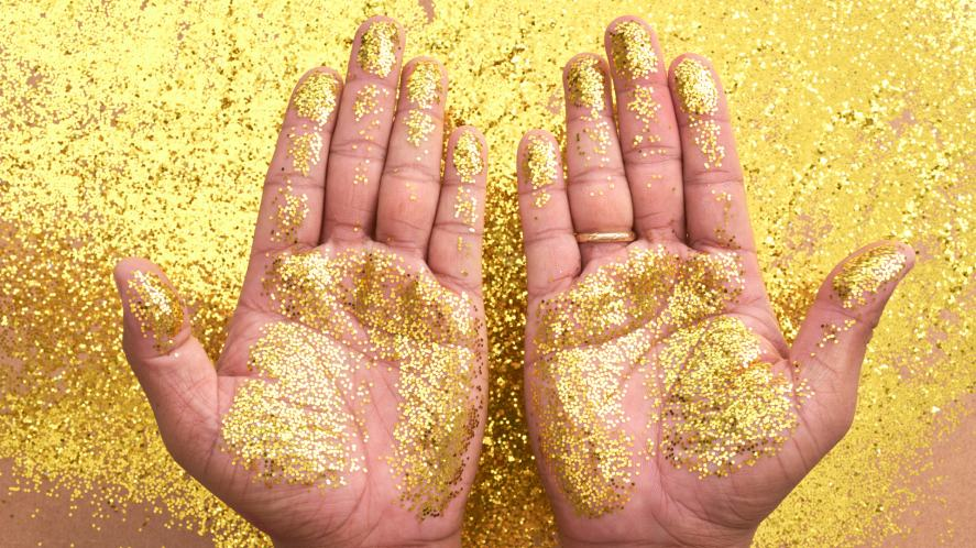 Two hands covered in glitter